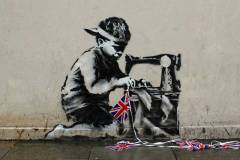 banksy-boy-sewing